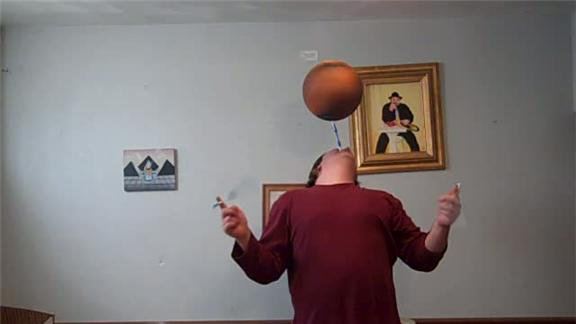 weird world records- Spinning Basketball on a Toothbrush Held in mouth