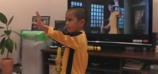 little boy imitating Bruce Lee