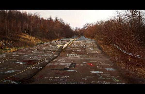 An Abandoned Highway With Road Painted In Graffiti