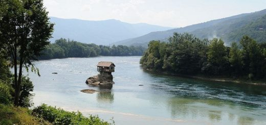 Strange Houses - house has been built on a rock on river Drina in Western Siberia